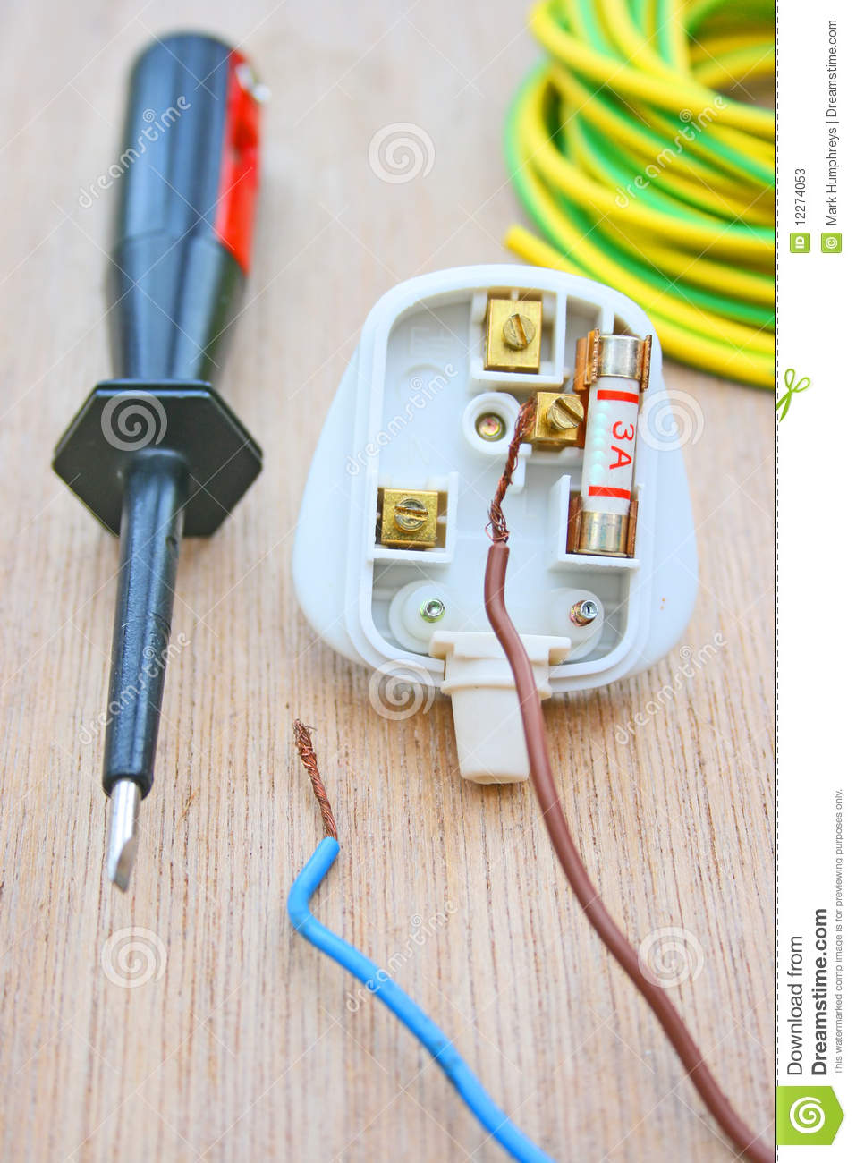hight resolution of household electrical plug fitted with a three amp fuse and with live and neutral wires disconnected also an electricians screwdriver with earth wire sleeve