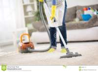Housewife Clean Carpet With Vacuum Cleaner Stock Photo