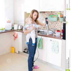 Shoes For Work In The Kitchen One Handle Faucet Houseworking Stock Photo Image Of Concentrated Tender