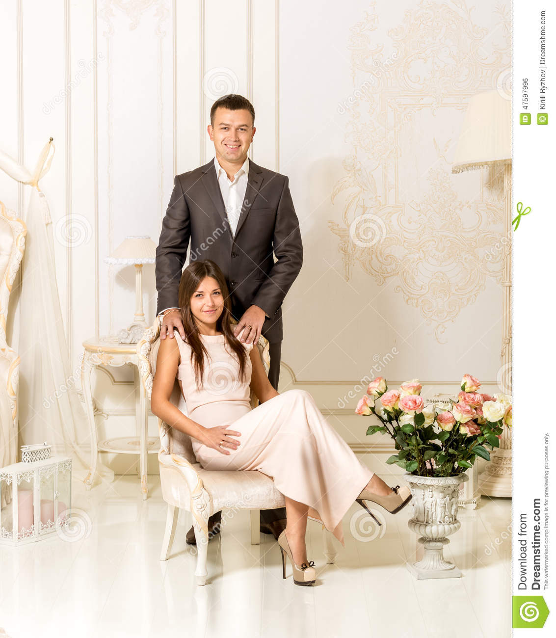 Husband Chair Husband Standing Behind Wife Sitting In Chair At Luxury