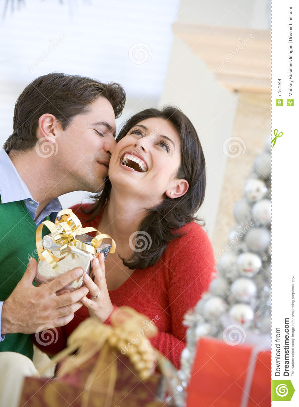 Husband Surprising Wife With Christmas Present Stock