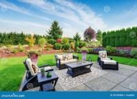 Impressive Backyard Landscape Design With Patio Area Stock ...