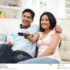 A Sofa In The Forties Modern Chesterfield Singapore Indian Couple Sitting On Watching Tv Together Royalty ...
