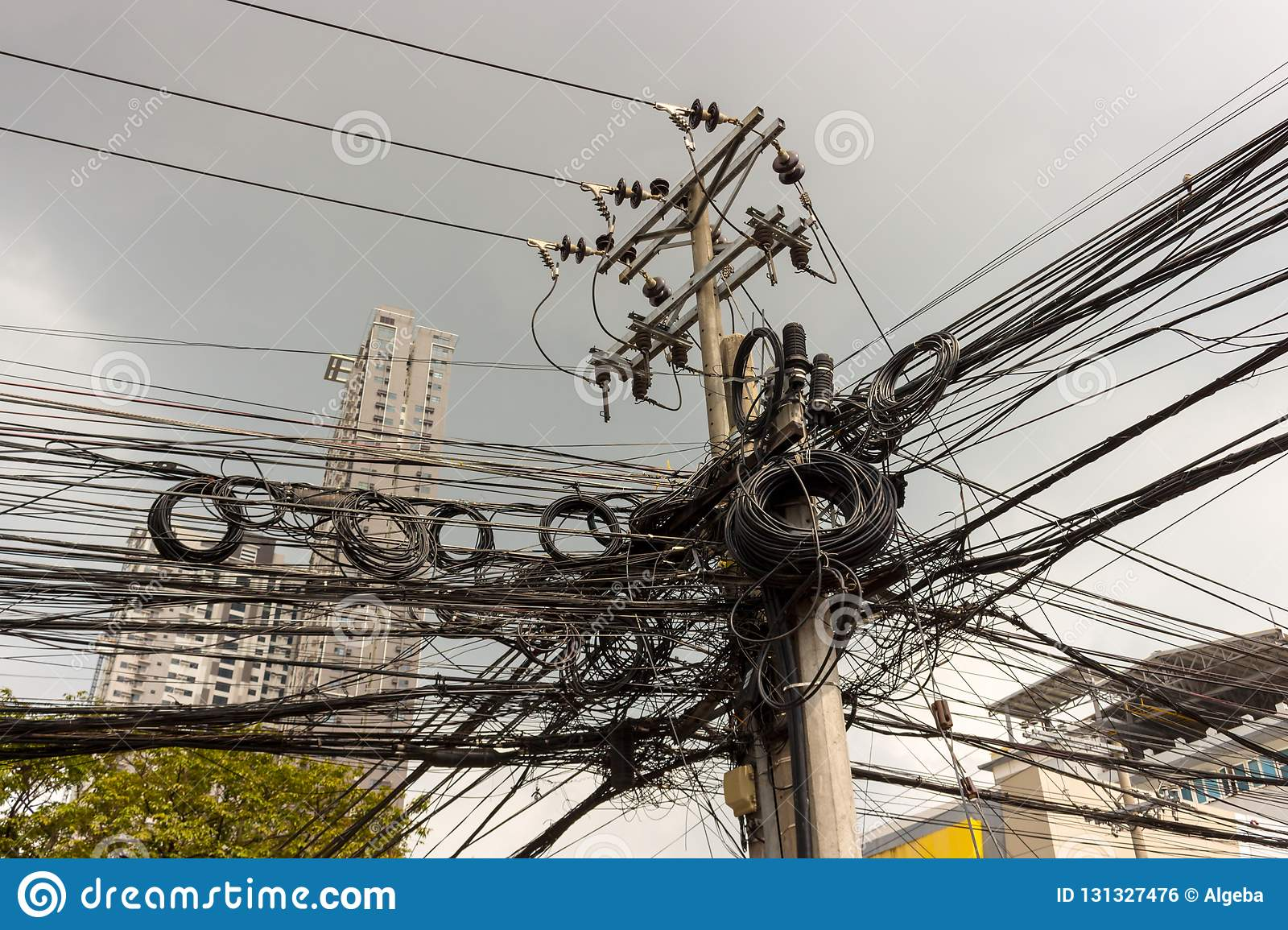 hight resolution of industrial background of messy electrical wires and insulators on the concrete pillar disorderly connection of wires and cables in philippines