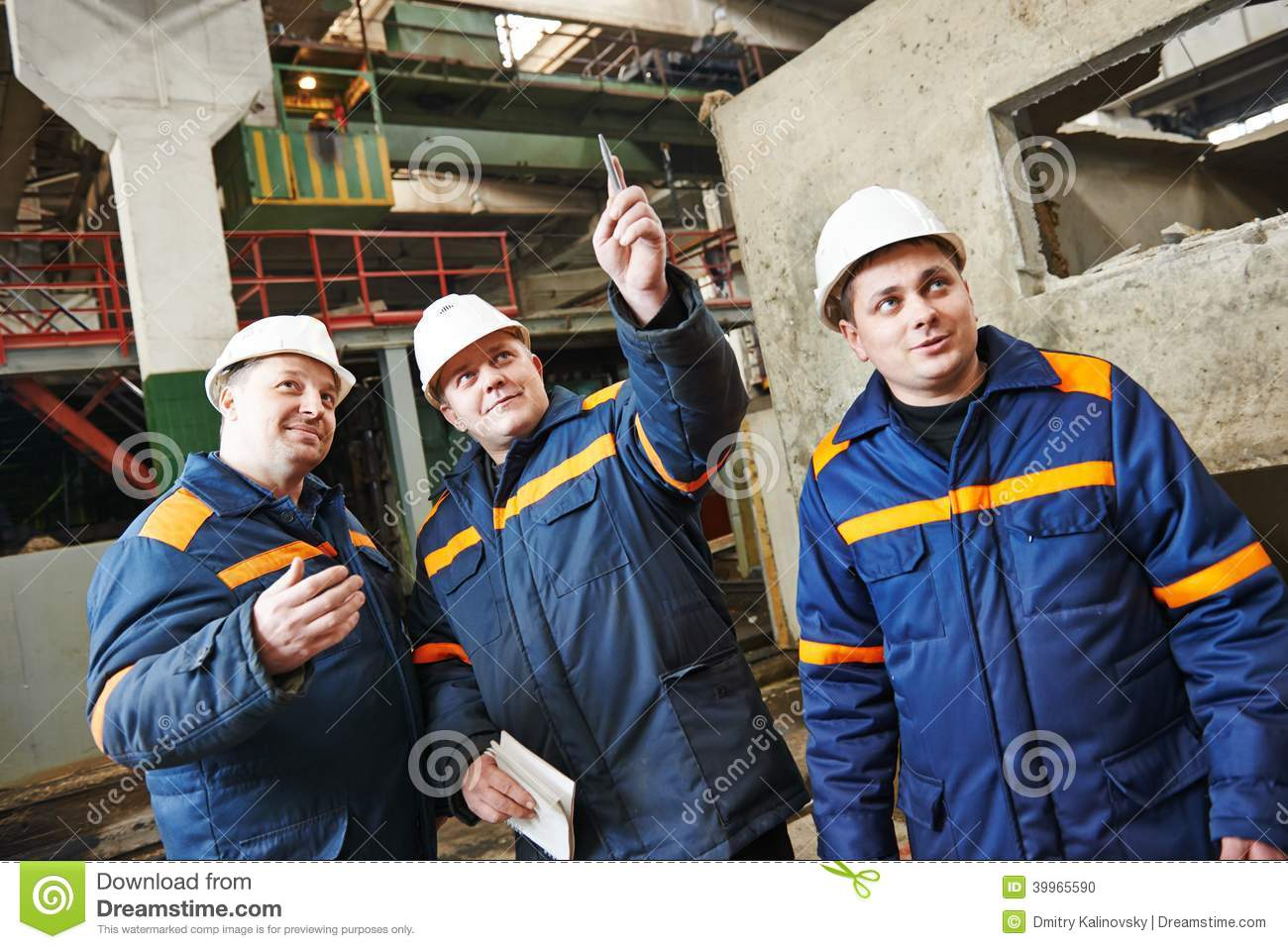 Industrial Workers On House Building Plant Stock Photo