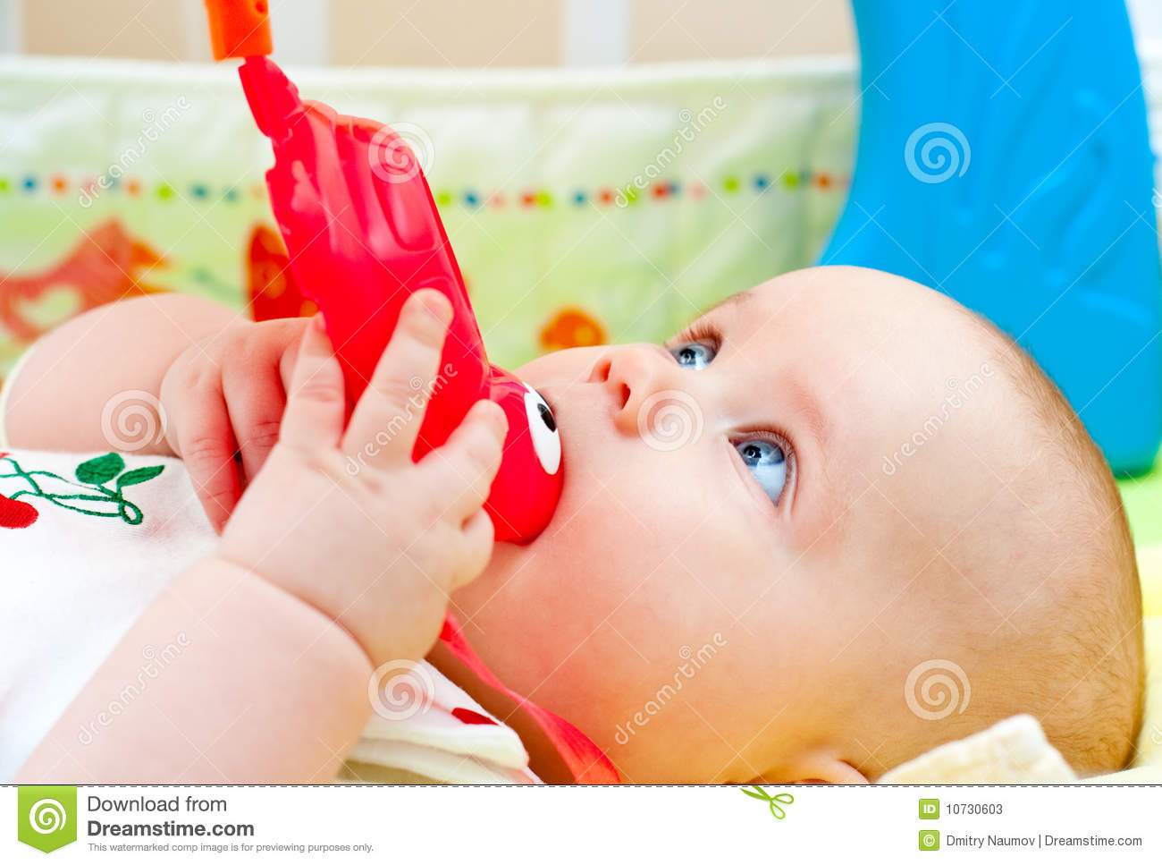 Infant With Teething Toy Stock Photos