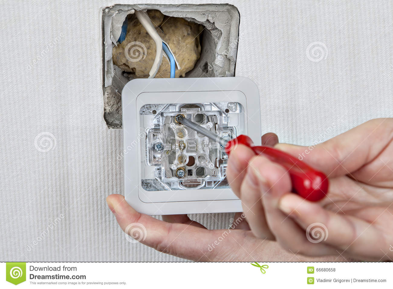 hight resolution of replacing electric wall light switch connection to the electrical wiring tightening the using a screwdriver