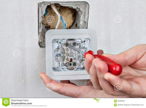 small resolution of replacing electric wall light switch connection to the electrical wiring tightening the using a screwdriver