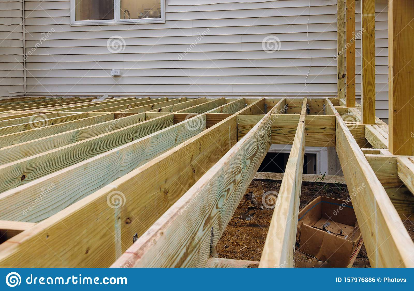 https www dreamstime com installing deck patio construction boards above ground porch floorboard installation woodwork terrace carpentry timber wooden image157976886