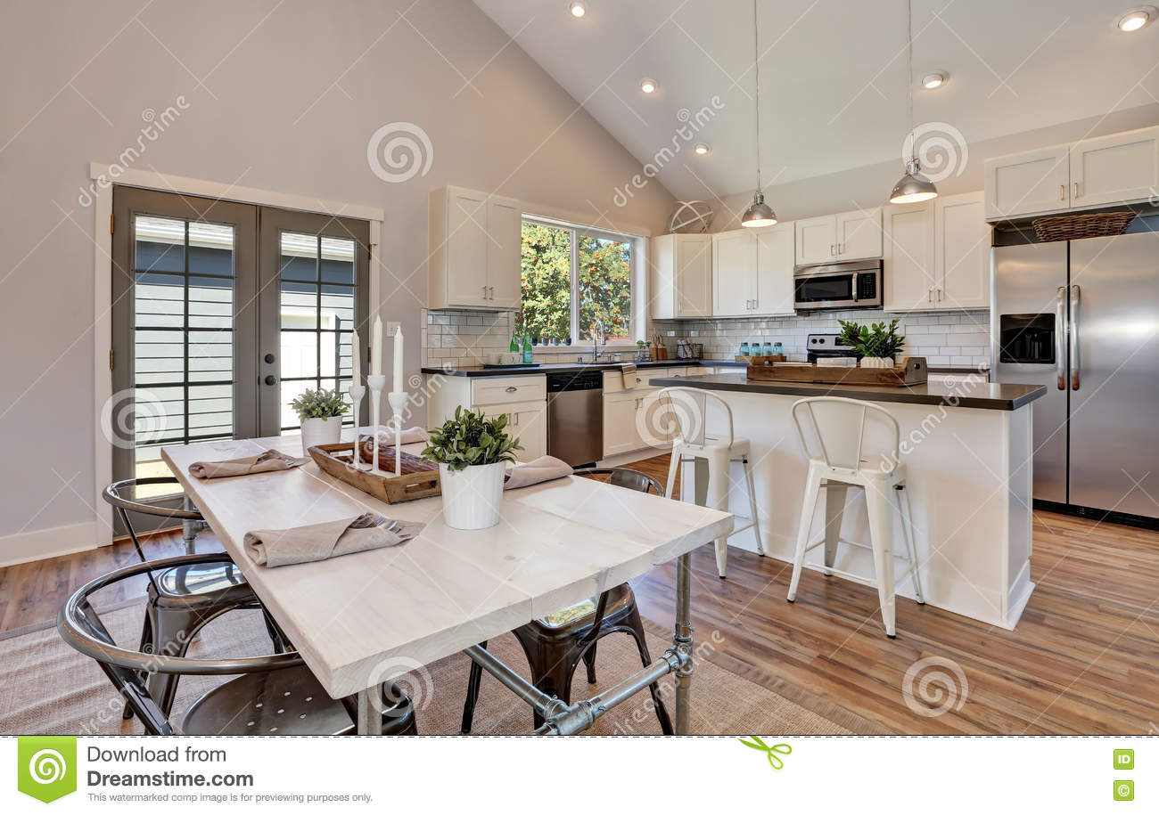 Interior Of Kitchen And Dining Room With High Vaulted