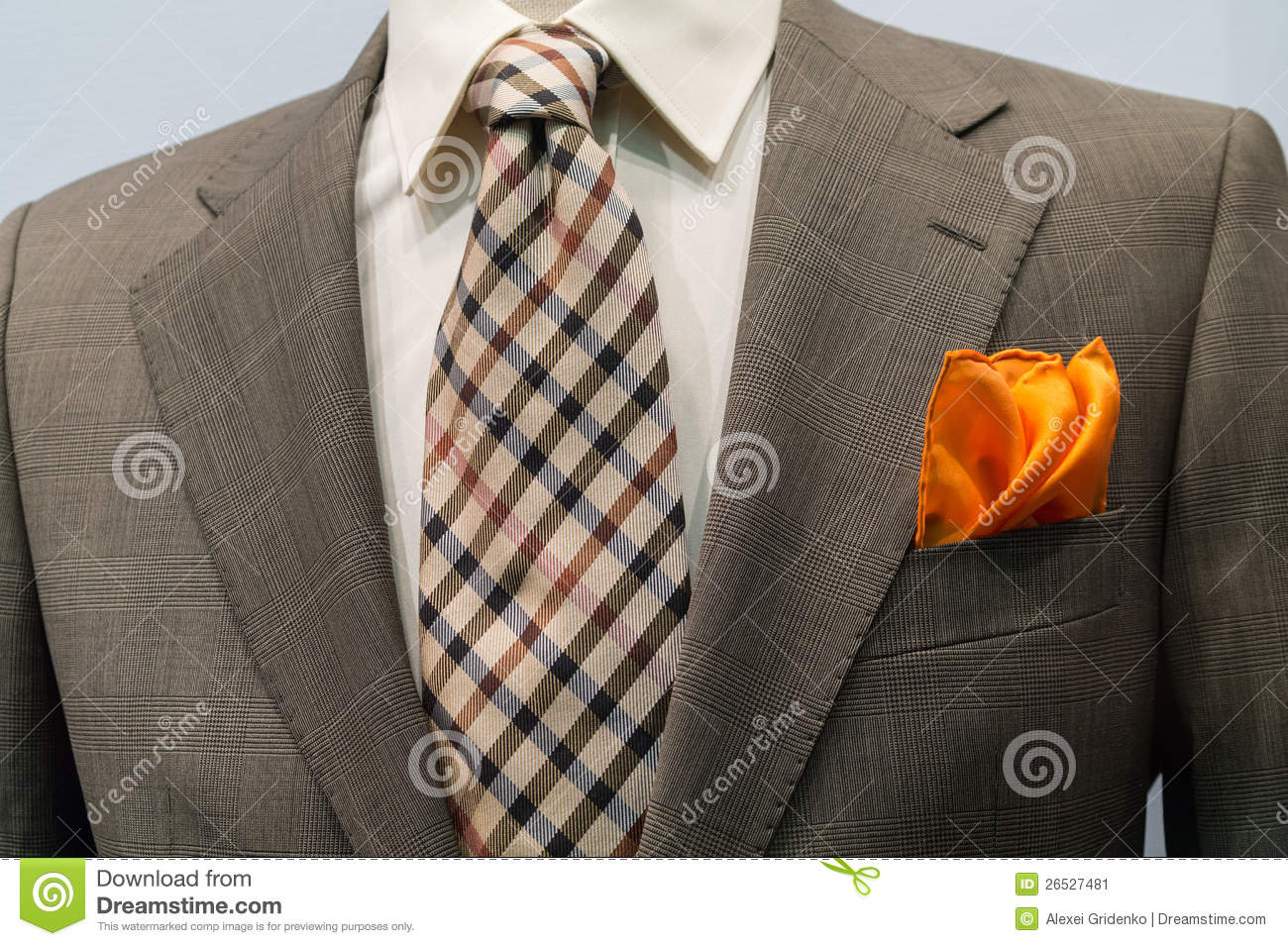 Jacket With Brown Checkered Tie And Orange Handker Stock