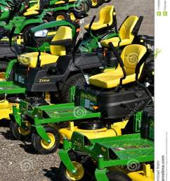 hawley minnesota august 22 2017 a row of green and yellow new riding lawn mower tractors are products of john deere co an american corporation that  [ 957 x 1300 Pixel ]