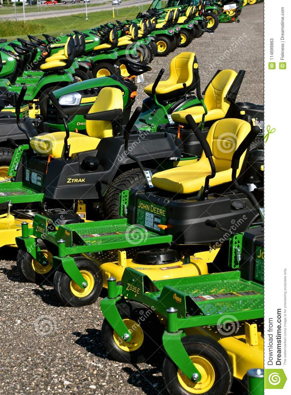 hight resolution of hawley minnesota august 22 2017 a row of green and yellow new riding lawn mower tractors are products of john deere co an american corporation that