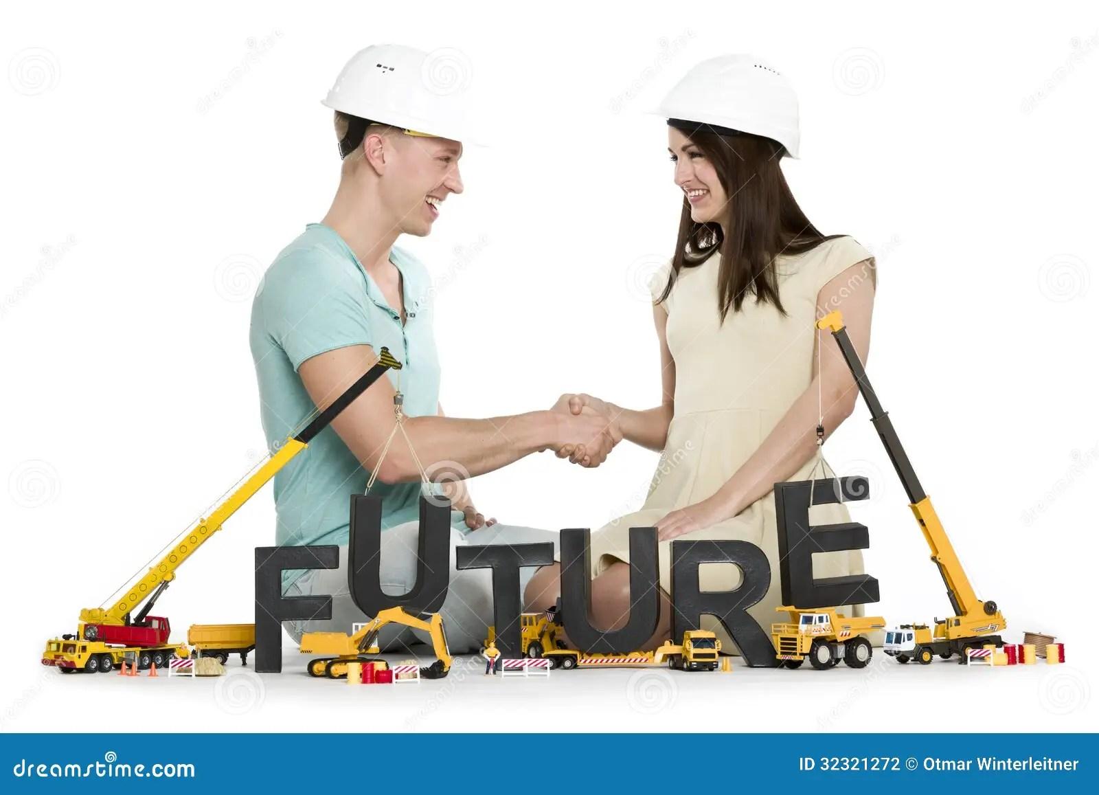 Joyful Man And Woman Building Up Their Future Stock Photo