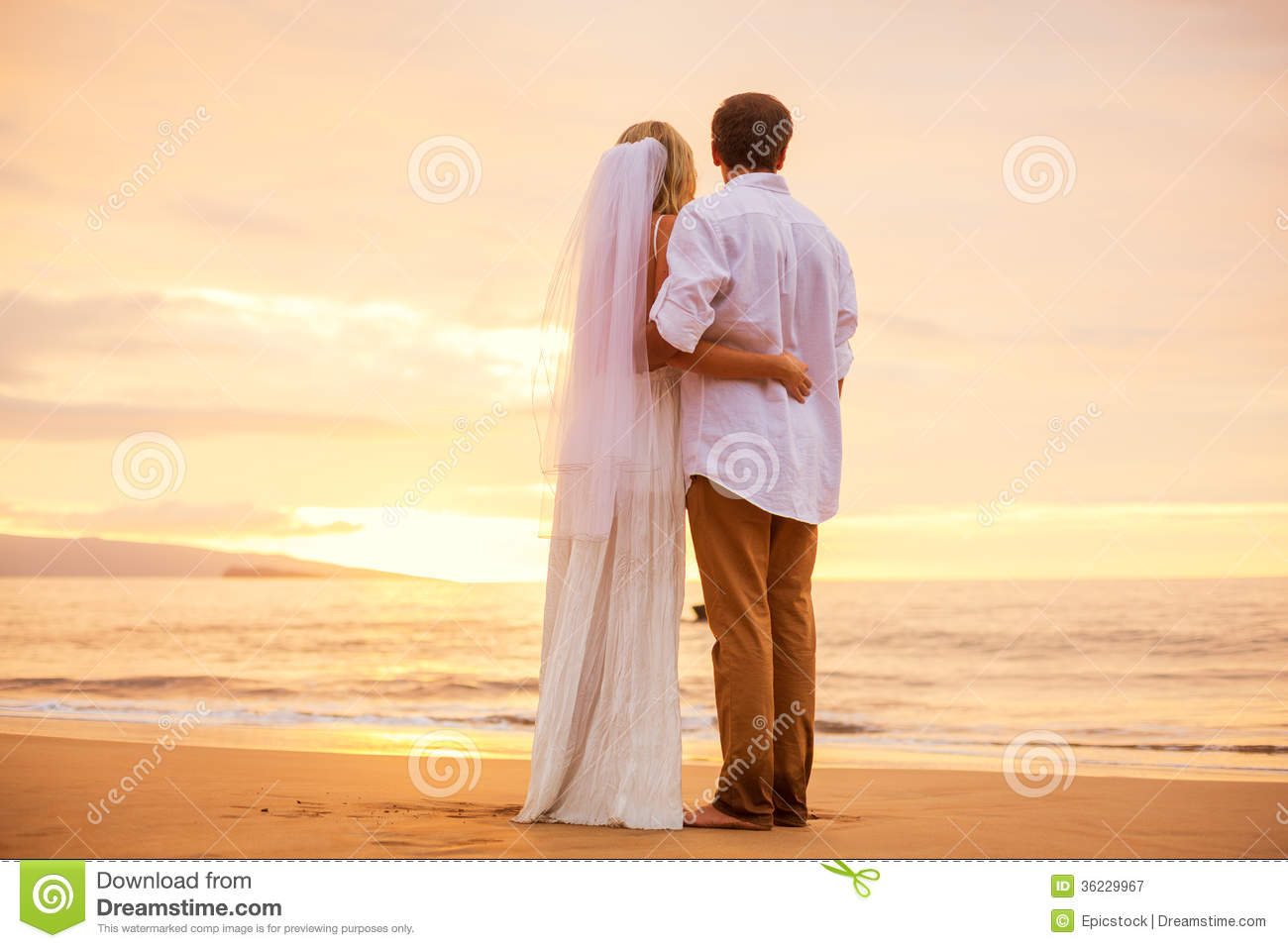 Just Married Couple On Tropical Beach At Sunset Stock