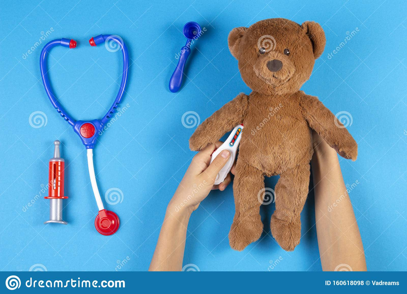Kid Hands Measuring Temperature With Toy Thermometer Of