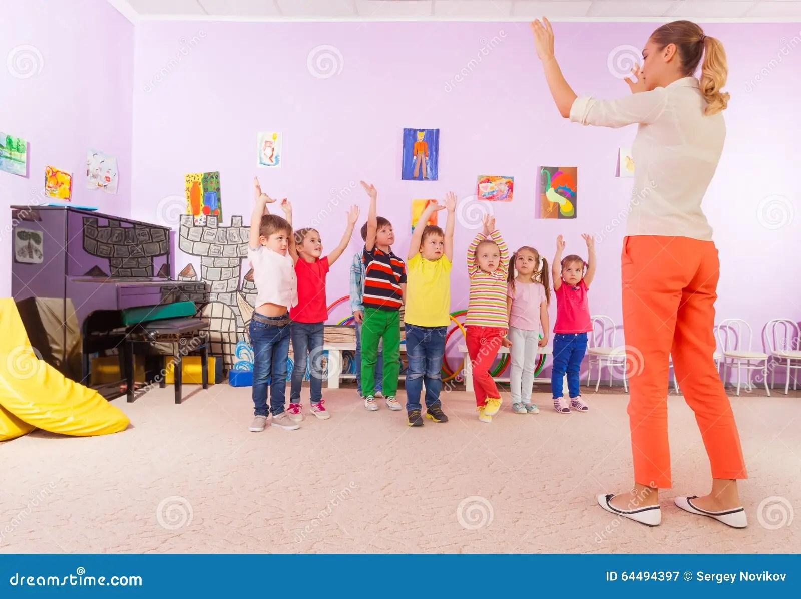 Kids Boys And Girls In Kindergarten Sport Class Stock