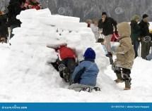 Kids Building Igloo Snow House Stock