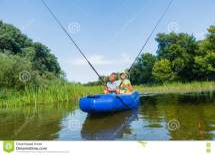 Kids Fishing River Stock