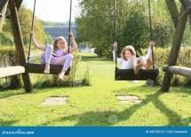 A Kids Swinging On Swing Barefoot
