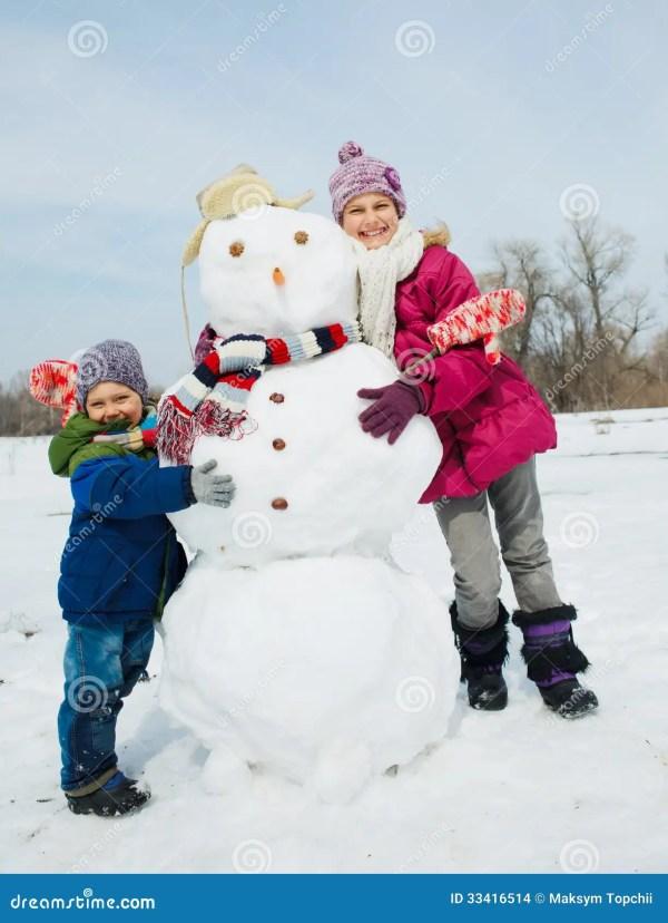 Kids make a snowman stock photo Image of child christmas