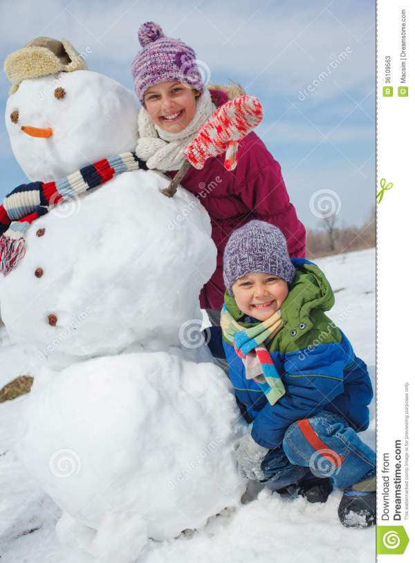Kids make a snowman stock image Image of person park