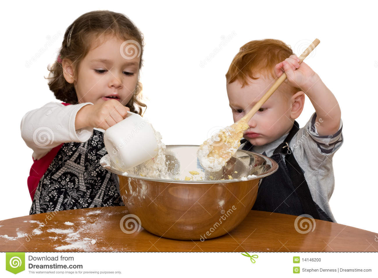 Kids Measuring And Mixing In Kitchen Stock Photo