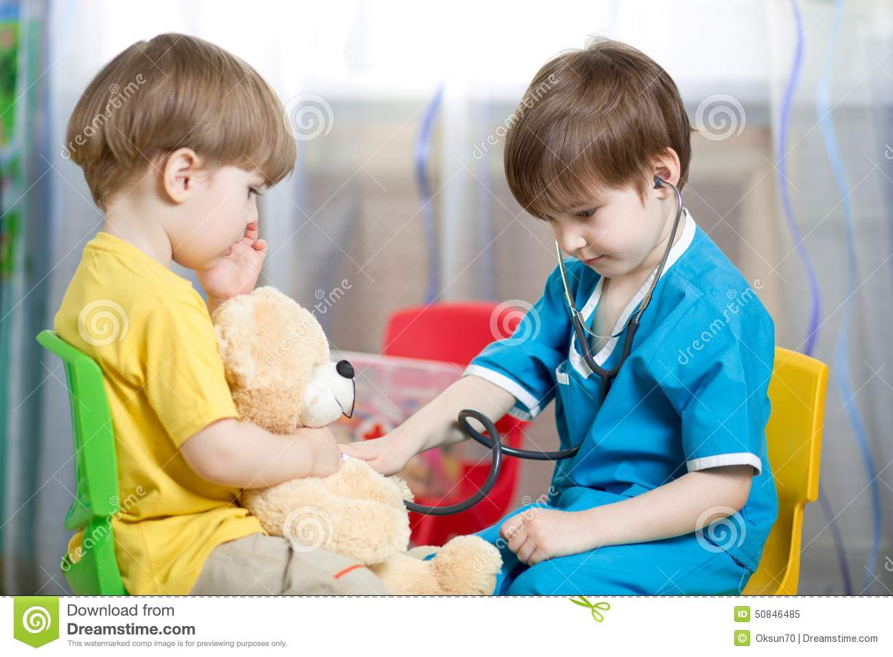 Kids Play Doctor With Plush Toy Stock Image