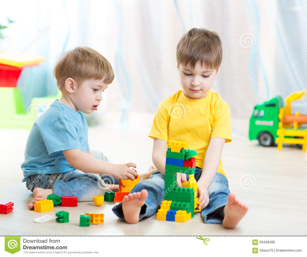 Kids Playing In Playschool Or At Home Stock Photo