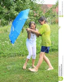 Kids Splashed With Garden Hose Stock - 42627660