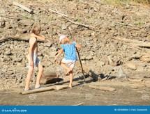 Little Girl Walking Barefoot in Mud