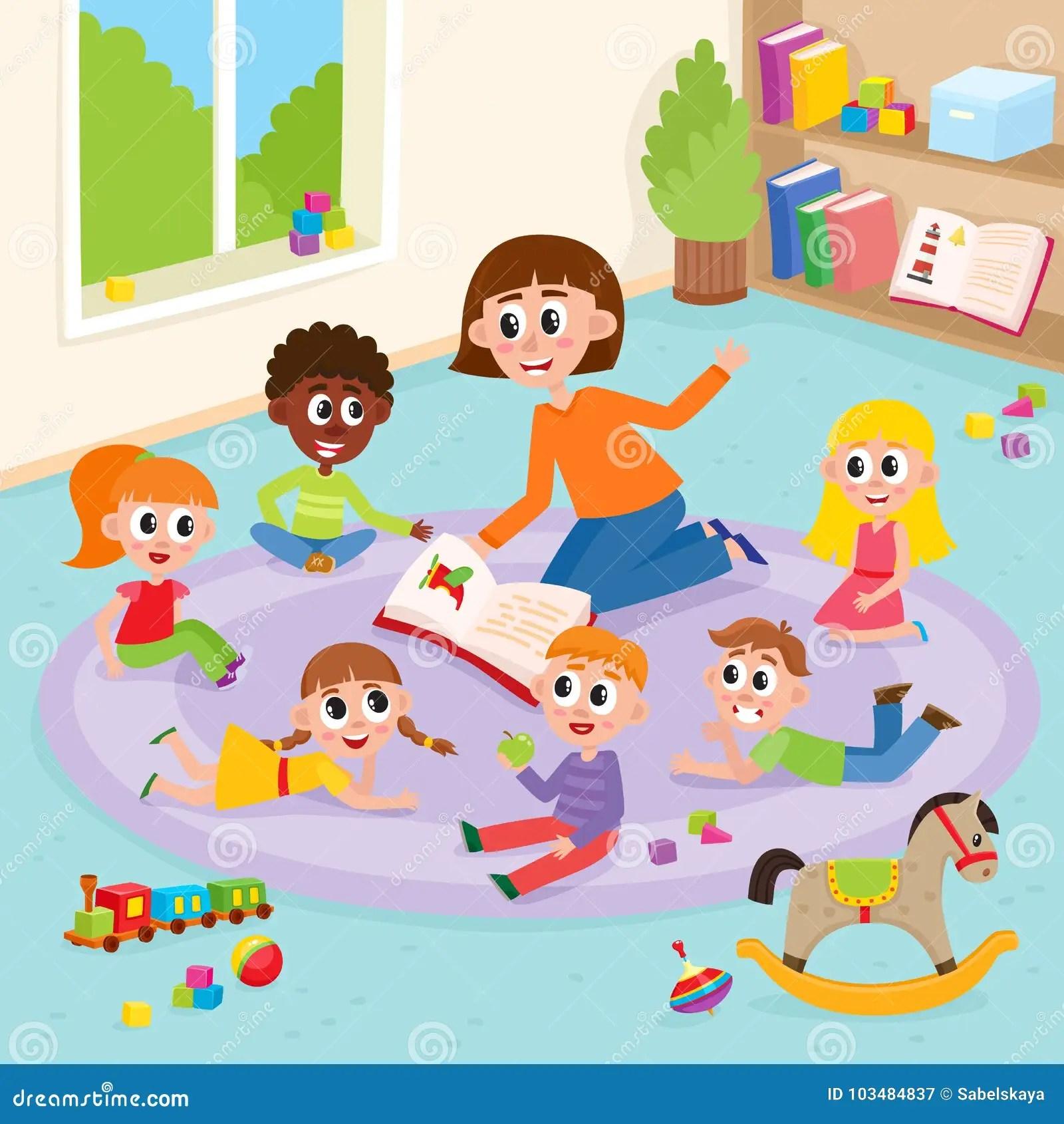Kindergarten Kids In Classroom And Teacher Reading Stock