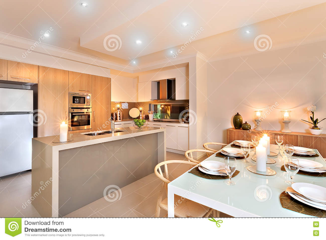 kitchen candles blue chairs and dinner table set up with flashing ready for