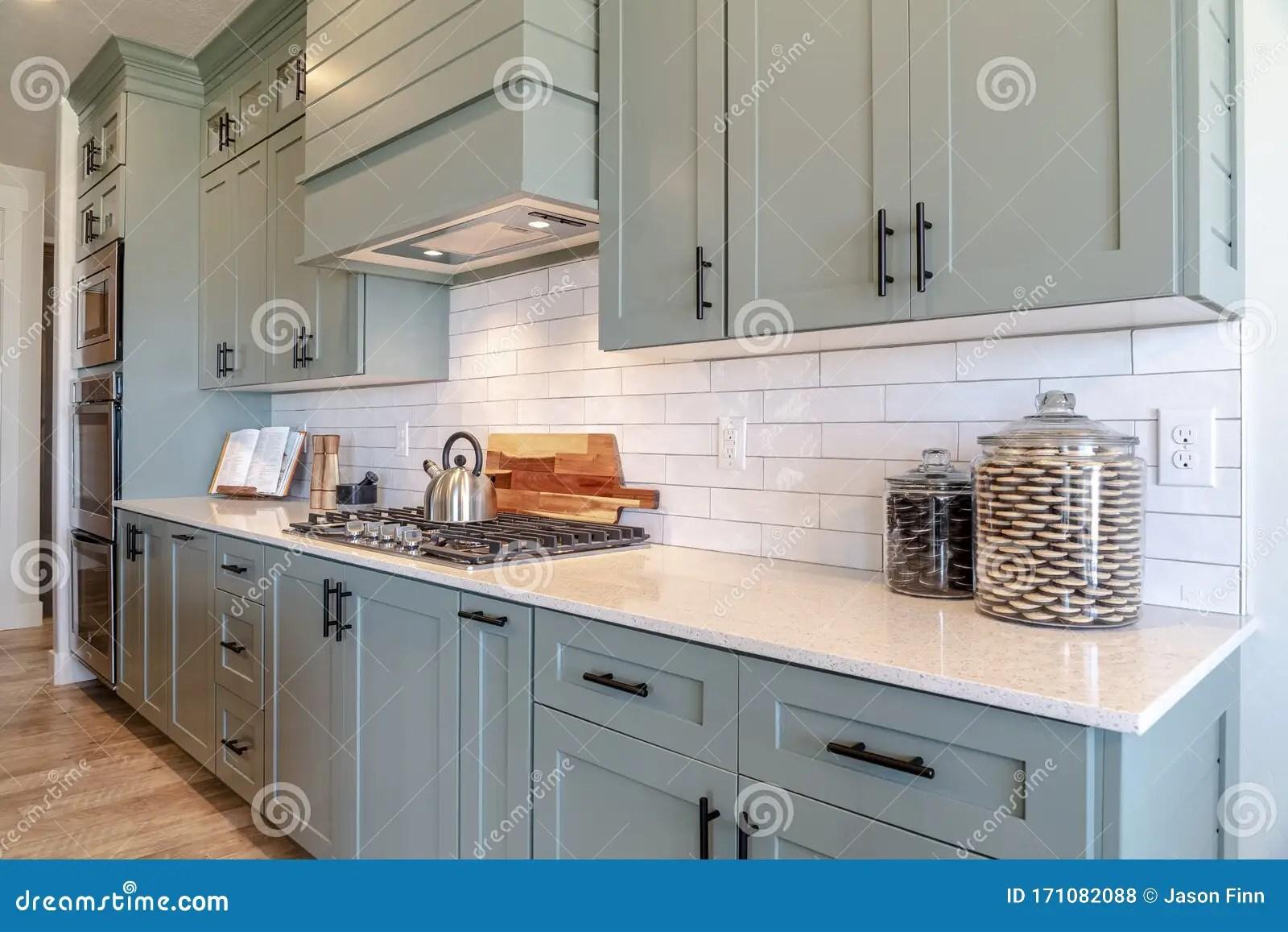https www dreamstime com kitchen interior cooktop white counter top under hanging cabinets appliances wooden floor tile backsplash can also be image171082088