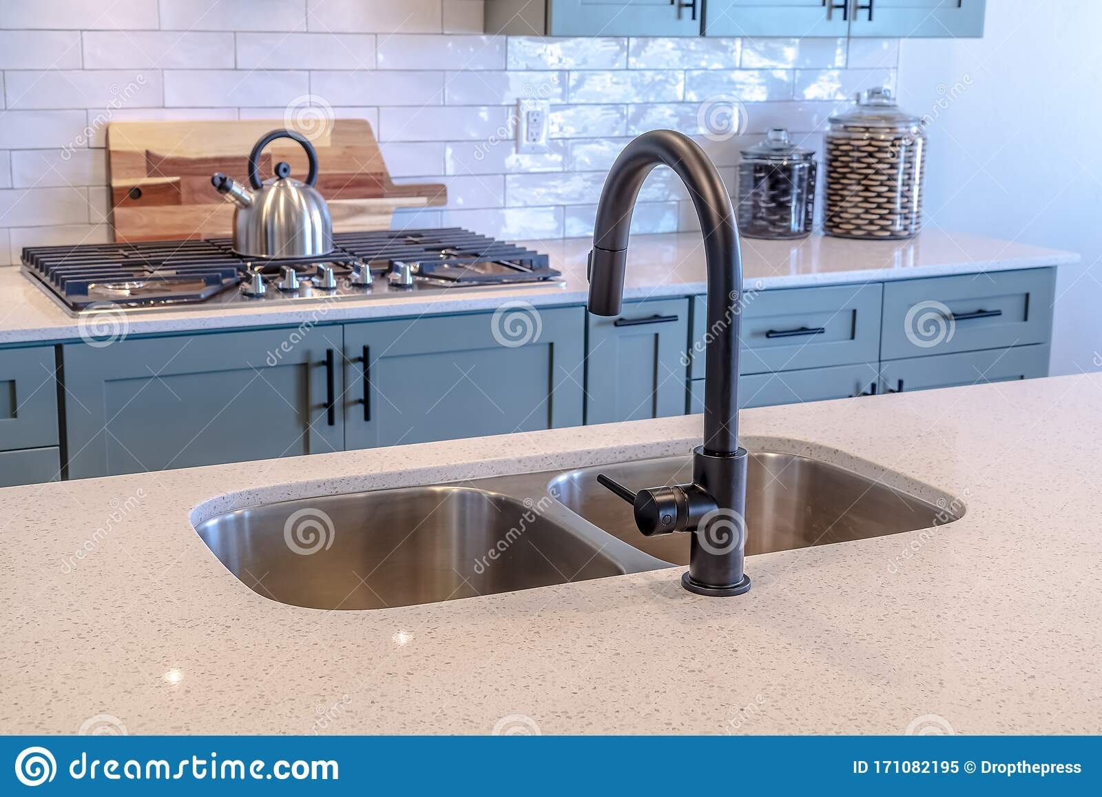 https www dreamstime com kitchen island double sink black faucet against cooktop tile backsplash wooden cabinets handles can also be seen image171082195