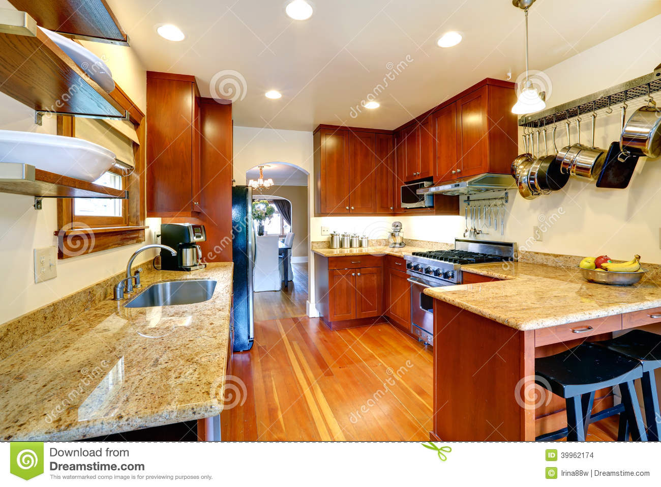 Kitchen Cabinets Hanging From Ceiling Kitchen Room With Archway To Dining Area Stock Photo