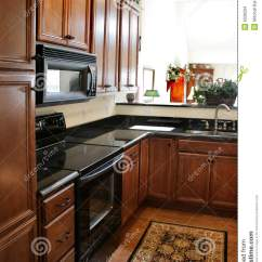 Comfortable Kitchen Chairs Modern Backsplash Wood Cabinets Black And Stainless Stove Stock ...
