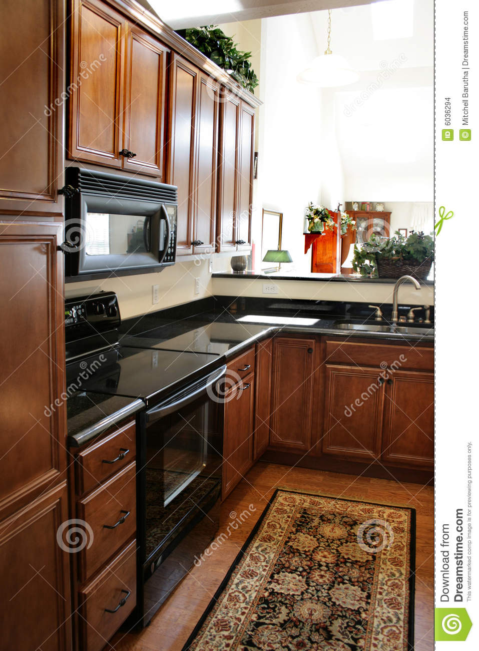 small comfortable chair wicker papasan kitchen wood cabinets black and stainless stove stock photo - image of oven, design: 6036294