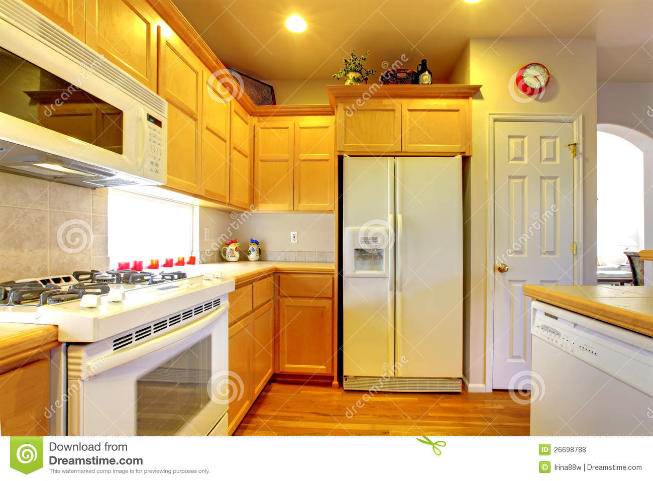 Kitchen With Yellow Wood Cabinets Royalty Free Stock