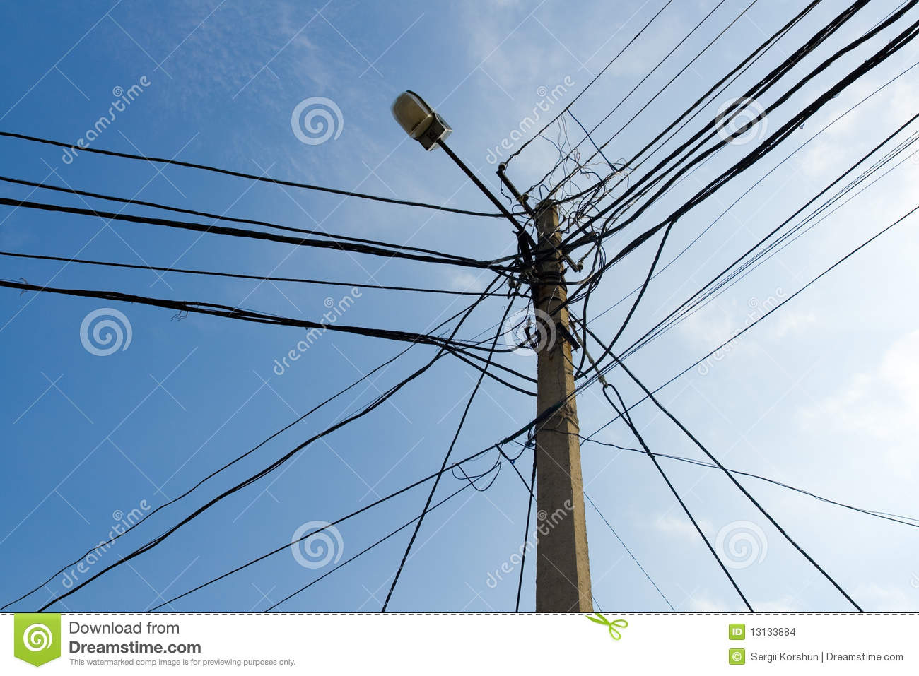 hight resolution of lamp pole and cross of tangled electric wires