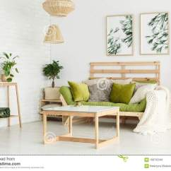 Green Cushions Living Room Photos Of Small Modern Rooms Floral Posters In Stock Photo Image Interior Lamps Above Table And On Wooden Couch Near Plants Shelf Against Wall With
