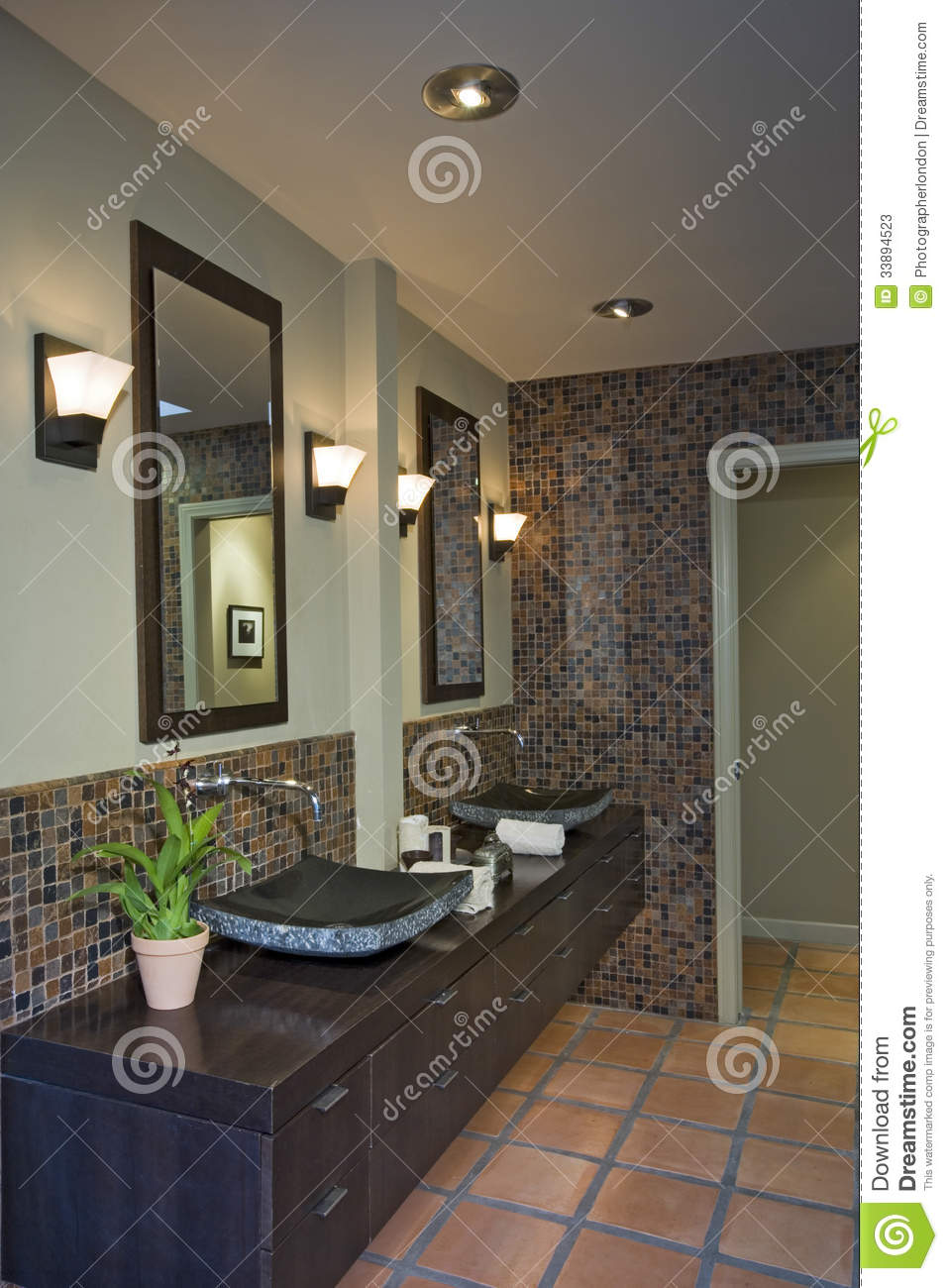 Lamps By Mirrors Over Sinks In Bathroom Stock Image