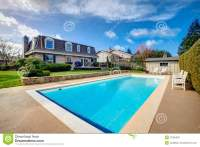Large Backyard With Flowerbed And Swimming Pool Stock