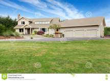 Large Beige House With White Trim And Lawn