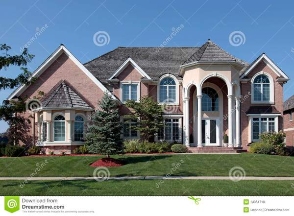 Large Brick Home With Columned Entryway Stock