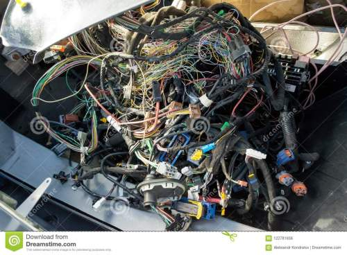 small resolution of a large tangle of ravel multicolored wires from the car wiring