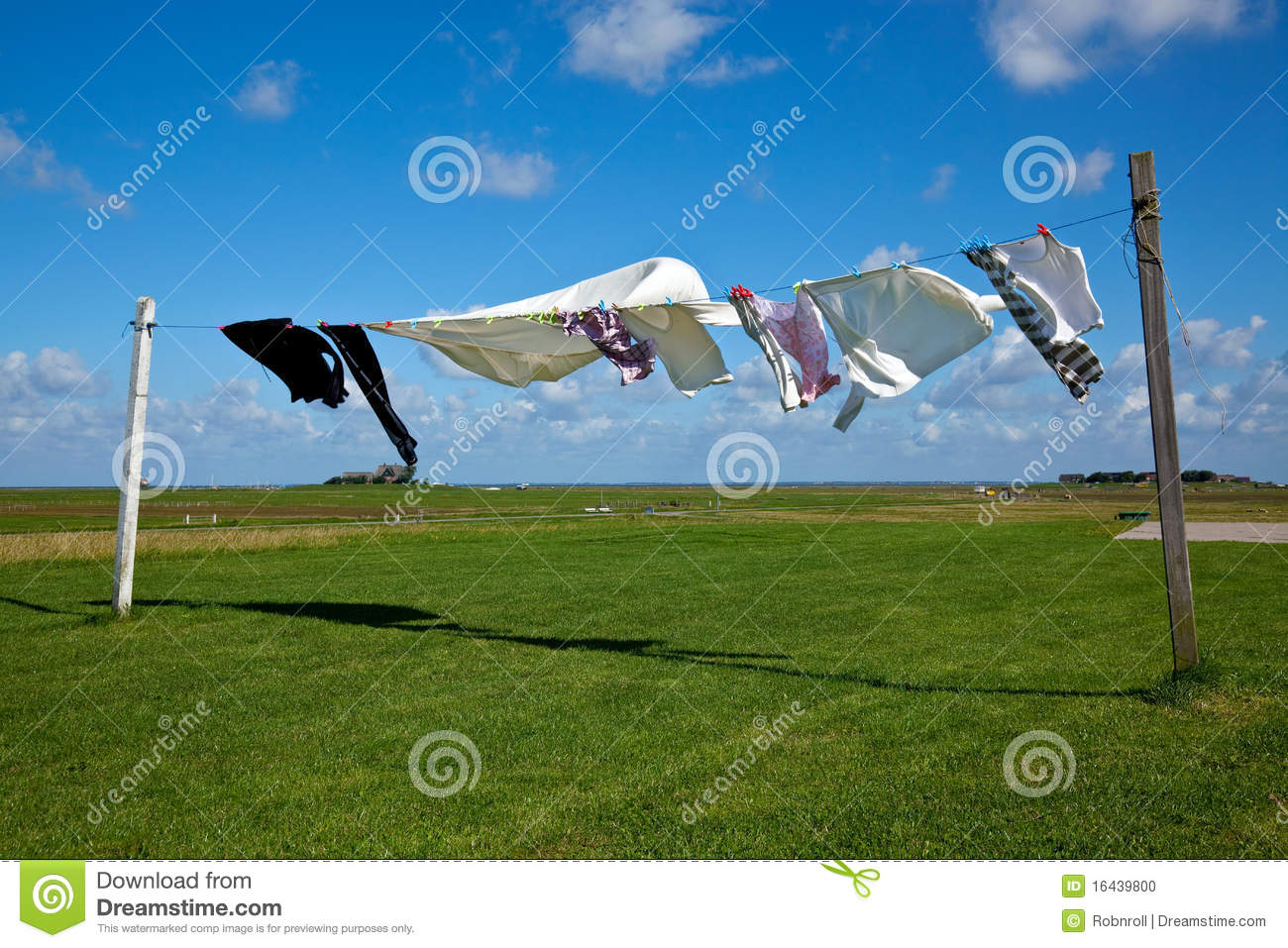 Laundry Drying On Clothes Line Against A Blue Sky Stock