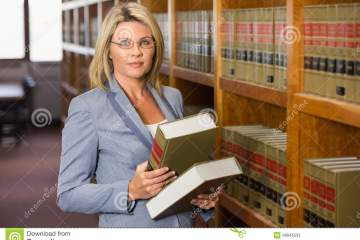 Lawyer Holding Books In The Law Library Stock Photo