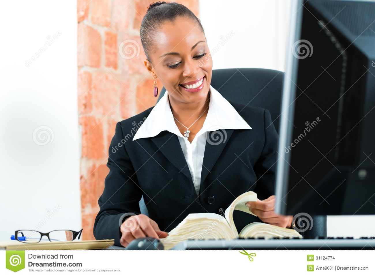 Lawyer In Office With Law Book And Computer Stock Photo