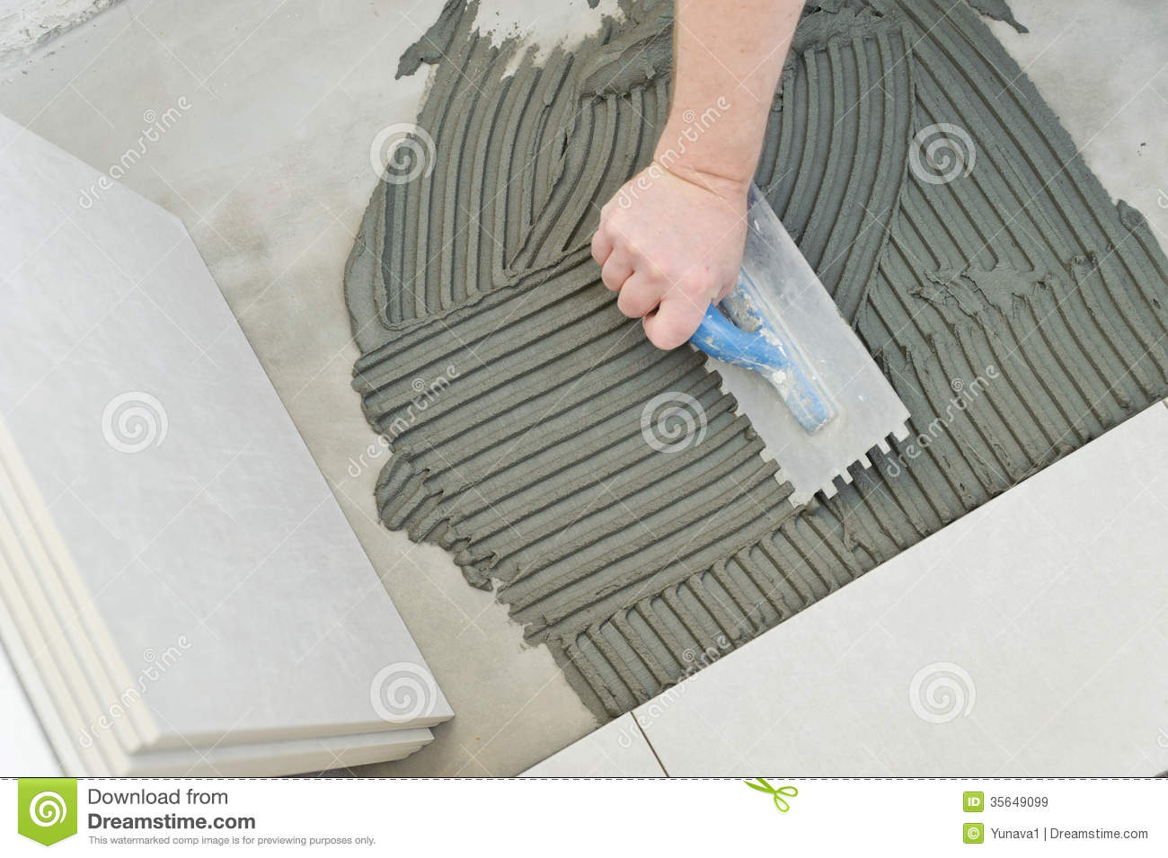 Laying Ceramic Tiles stock image Image of building home